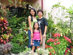 Yanti, Dylea and Jacq at our frontyard garden, taken December 16, 2006