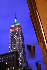 Empire (Farl) Tags: nyc newyorkcity longexposure travel usa ny newyork colors night buildings lights us skyscrapers dusk manhattan flags spire midtown empire empirestatebuilding empirestate 5th 34th starsandstripes notripod 5thave proppedup 34thst 5thav