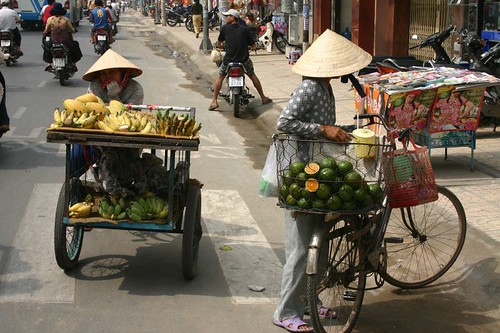 The backbone of many peoples' life in Saigon: selling foods and stuff in the streets