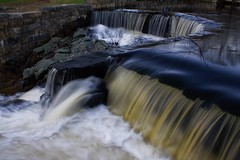 Southford Falls (kotobuki711) Tags: statepark blue trees sunset brown black reflection green water yellow reflections waterfall movement dusk ripple connecticut gray ct swift ripples silouettes southfordfalls newenland impressedbeauty