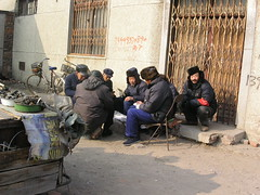 Xingcheng - Men in Fur Hats Playing Cards