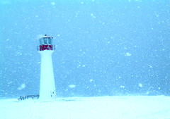 Snowstorm sentinel... (nadiableue) Tags: blue red lighthouse white snow rouge snowstorm bleu neige blanc phare ilesdelamadeleine magdalenislands 10faves anawesomeshot