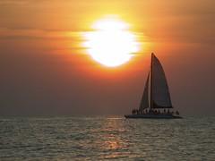 Sailing @ Sunset (riclane) Tags: sunset vacation sky sun beach clouds bravo florida outstandingshots nikonstunninggallery impressedbeauty superbmasterpiece beyondexcellence flickrdiamond
