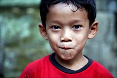 Children of Ta Prom: Ta (mboogiedown) Tags: temple hope cambodia december cambodian khmer child play january prom siem reap lollipop angkor ta province nations developing kampuchea cambogia khmersmile travelforpeace reab camboge soksabay beatravelernotatourist itsallaboutthepeople reasontolearnkhmer peopleiwillneverforget seimreab hopelessfriendmaker ifthephotographerisinterestedinthepeopleinfrontofhislensandifheiscompassionateitsalreadyalottheinstrumentisnotthecamerabutthephotographerevaarnold