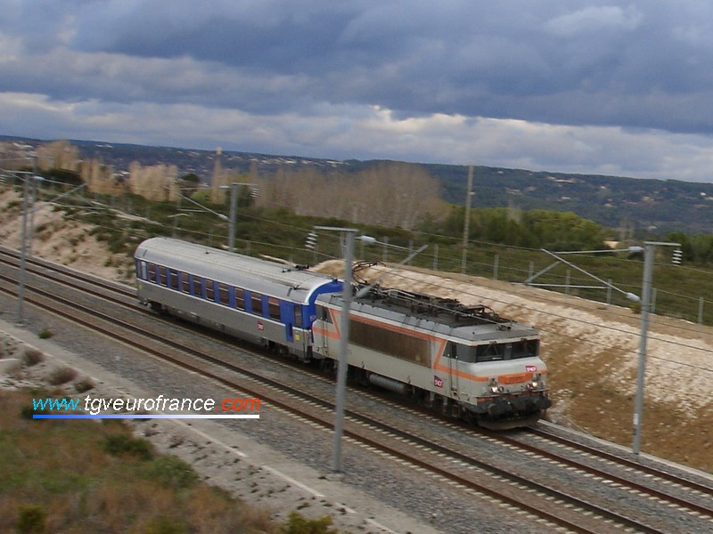 A BB22200 electric locomotive (BB 22379) dedicated to the maintenance of SNCF high speed railways hauling a coach equipped with various sensors checking the signalling infrastructure on the Valence-Marseille line near the Aix-en-Provence TGV station on 23 January 2007
