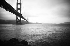 Vintage Bridge at Dusk (Thomas Hawk) Tags: sanfrancisco california city bridge blackandwhite bw usa water night clouds lights blackwhite rocks unitedstates 10 unitedstatesofamerica goldengatebridge marinadistrict fav10 photowalking photowalkwithrobertscoble photowalking1 natureshand