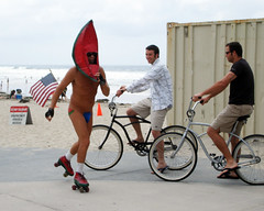 Crazy Watermelon guy with a flag up his butt (San Diego Shooter) Tags: ocean california city travel girls sunset vacation sun seagulls beach nature beautiful sunshine birds animal animals skyline museum landscape fun bay bars downtown sandiego trolley seagull ships paintings restaurants statues sunsets carlsbadflowerfields lajolla pb tourist best gaslamp oceanbeach clubs dining traveling pacificbeach southerncalifornia museums swimsuits balboapark aerospace sandiegobay delmarhorseraces