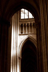 Inside (brun_o) Tags: light bw france church lines mystery sepia architecture religious arch cathedral faith curves pillar rouen normandy