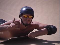 Hubbers sandboarding in Namibia