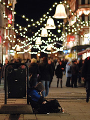...and a merry christmas to you too, sir (Rune T) Tags: christmas street xmas money cup oslo contrast shopping iso800 lights sitting dof bokeh main rich poor 85mm beggar ornaments merry f18 begging streetshot mop122006