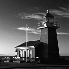 Mark Abbott Memorial Lighthouse at Dawn (musicmuse_ca) Tags: blackandwhite bw santacruz lighthouse museum 1025fav 510fav wonder dawn interestingness fantastic flag westcliffdrive lighthousepoint lighthousefieldstatebeach interestingness194 i500 123bw santacruzsurfingmuseum surfersmemorial
