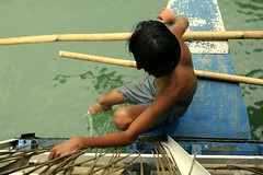 sakay (Farl) Tags: travel cruise boy sea water colors river boat paint philippines cruising bamboo bow bohol flaking loboc