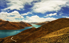 Yamdrok Tso (Turquoise) Lake, Tibet (Katarina 2353) Tags: china sky mountain lake snow mountains fall film nature clouds landscape photography spring nikon asia paradise view image path hill dream paisaje tibet cielo valley paysage range priroda himalayas himalayan yamdroktso tjkp pejza tibetanlandscape katarinastefanovic katarina2353 gettylicense