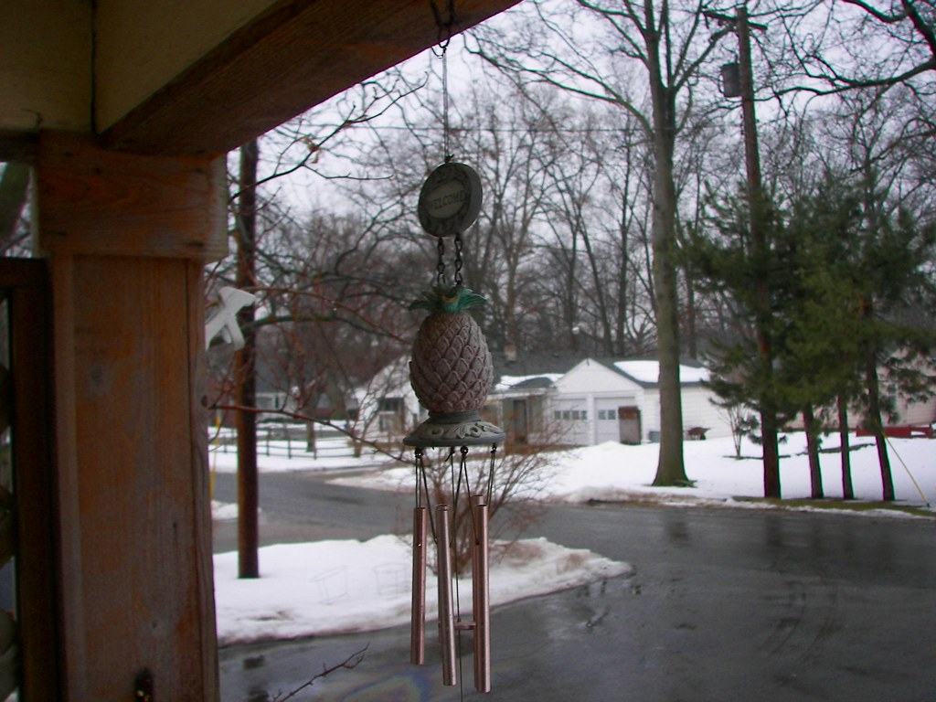 Pineapple wind chimes on an Ohio porch blowing in the wind