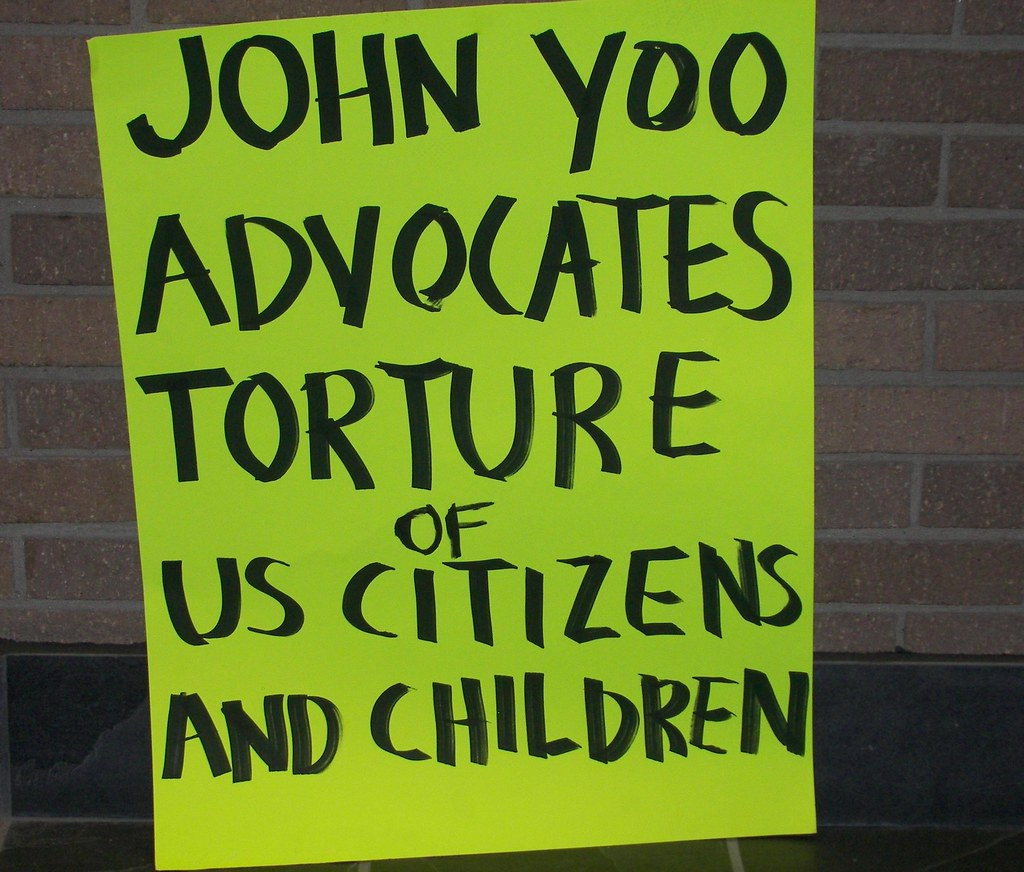 Sign of protesters who greeted legal scholar John Yoo in Toledo