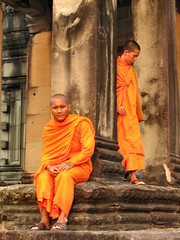 The Monks (Danil) Tags: people orange colors stone tom asia cambodia jungle monks temples ankor persons ankorwat siemriep