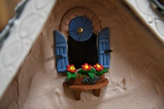 Sweet Loft window! (ineedathis,The older I get the more fun I have....) Tags: 2016christmas gingerbreadhouse modeling miniature gumpaste sugarworks baking window balcony flowers eave roof shutters gingerbreaddecorations nikond750 royalicing