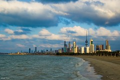Kuwait City - Windy day (Khalid AlHaqqan) Tags: sea beach canon buildings coast waves skyscrapers wind kuwait usm 1855mm efs archeticture kuwaitcity shuwaikh q8 f3556 kuwson