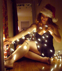 Merry Christmas 4 (QXZ) Tags: christmas light party portrait woman holiday cute girl beautiful beauty brooklyn pose glamour pretty december tara feminine seasonal posed 2006 hallway christmaslights sparkle actress santahat tangle blackdress woodflooring extrovert