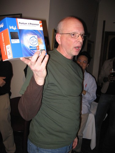 Howard Carson, of KickStart Media, auctions tech items for the Toronto Web Centric Meetup Group
