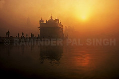 Foggy Morning At The Golden Temple (Raminder Pal Singh) Tags: india punjab amritsar religion divine culture sikh sikhism sunrise silhouette nectar respect shrine sacred world god mandir spiritual prayer travel ancient legendary eminent guru acceptance openness ostensibly thepca enlightenment nirvana source inspiration meditate ponder wonderful building black sky dome weather fog golden red sun peep cloudy water goldentemple darbarsahib harimandirsahib sachkhand sikhi view glory magnificent marvellous amazing stunning outstandingshots flickrplatinum travelerphotos topf100 fivestarsgallery world100f