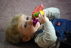infant happily playing