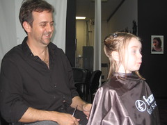 Raelyn poses for her haircut and picture