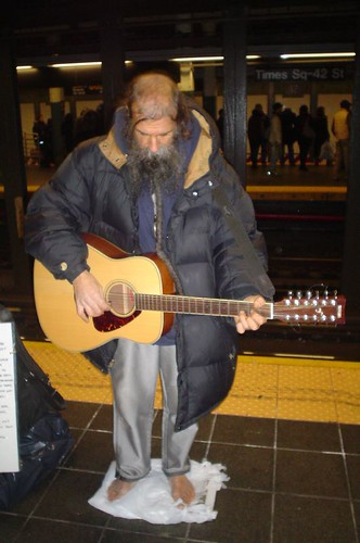 Barefoot guitar player
