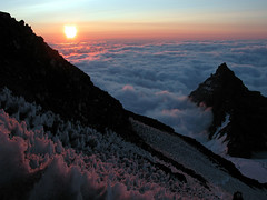 Sunrise on Mt. Rainier (TroyMasonPhotography) Tags: sunrise mountaineering mtrainier rmi washington disappointmentcleaver americanlungassociation climbforcleanair climb clouds suncup mountain snow nikonstunninggallery topvaa tahoma anawesomeshot helluva topf25 cotcmostinteresting quality topf50 wstpic07 topv999 topv1111 goldenphotographer focuslegacy superaplus aplusphoto serendipity topv2222 topv3333 mountrainier topv4444 tacoma topv5555 paradise longmire mountrainiernationalpark explore rainiermountaineering rainier wwwtroymasonphotographycom seattle campmuir 10000 wwwcleanairadventurescom mountains piercecounty tmason vacation tourism blackfriday rainierartsfestival httpwwwfacebookcompagesrainierartsfestival143133512410295vwall god travel nature interestingness photostream whittakermountaineering santa pacificnorthwest smile mountainclimb nationalpark josh checkthis