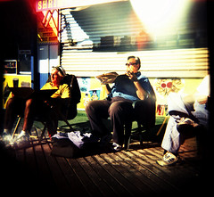 sunbathers (OuroborosX) Tags: sunshine coneyisland holga lomo lomography lightleaks sunbathing liad liadcohen ouroborosx