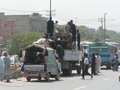 Govt men taking off the paddlers (Pix&Pixels Productions) Tags: pakistan islamabad august2006 tariqderya