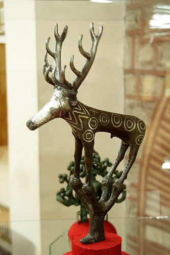 A side view of Stag statuette