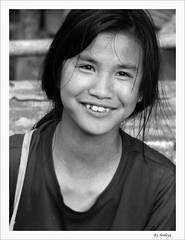 When a Girl Turned into a Woman (Araleya) Tags: travel bw girl smile children happy lumix fz20 kid asia southeastasia child monotone panasonic laos vangvieng araleya