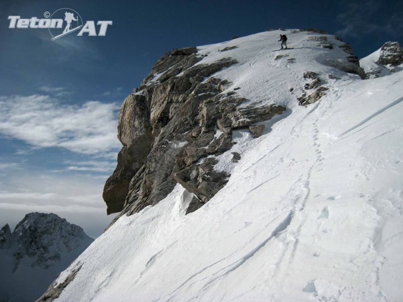 Dustin cautiously skis the East Ridge of the Dike Pinnacle on the Middle Teton