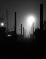Marina Night . 4 (Steven Schnoor) Tags: nightphotography blackandwhite bw usa art tourism water monochrome silhouette fog night marina canon boats outdoors washington fishing outdoor tourist pacificnorthwest environment 5d pilings dslr westport washingtonstate pnw washingtoncoast boatbasin graysharbor westernwashington schnoor simplelogic experiencewa experiencewashington