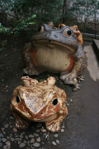 Frogs near tomb