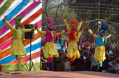 Bhangra (~FreeBirD~) Tags: people india color green yellow dance jump nikon asia shot d70 action d joy mani indians punjab capture 70 challenge bhangra punjabi 2007 balle rythym surajkund babbar februaury nikonstunninggallery lovemax manibabbar surajkund2007 maniya colorfuldresses httpbirdofpreyspaceslivecom httplamenblogspotcom