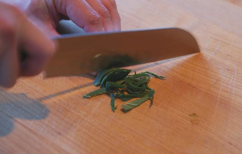 Chopping sage into a chiffonade