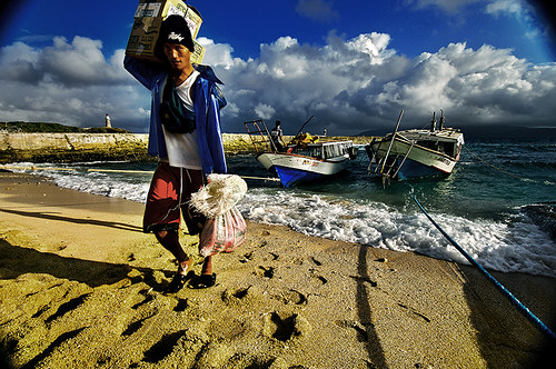 man boat sea seaside fisherman philippines pinoy Batanes