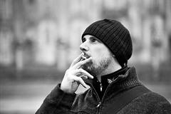 smoking (1) (lomokitty) Tags: winter portrait bw man male guy film hat germany beard deutschland blackwhite nikon dof bokeh cigarette smoke 2006 smoking sw mann done schwarzweiss potsdam stef 5018 f55 canonef50mmf18ii november2006