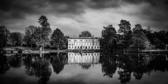 Kew Gardens - Other Side Of Lake by Simon & His Camera (Simon & His Camera) Tags: architecture building bw blackandwhite monochrome reflection house water lake landscape contrast cloud evening gardens horizon kew sky london outdoor simonandhiscamera tree vignette window kewgardens