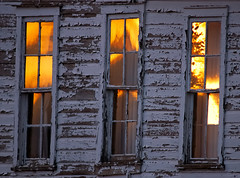 Weathered Sunset (Fort Photo) Tags: birthday windows sunset history reflections nikon bravo colorado peeling decay weld country 2006 co weathered prairie fading peelingpaint grassland ruraldecay grasslands decayed dilapidated eyecatcher notstraight neco fragments pawnee pawneenationalgrassland splendiferous 50faves 300f4 outstandingshots anawesomeshot