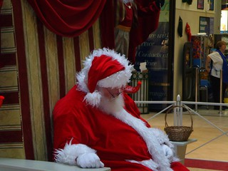Santa is sleeping at the Dufferin Mall, Toronto, ON