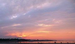 Cloudy Sunset (Ahmed Rabea) Tags: blue sunset sea orange tree green water fence bahrain yacht gray palm cloude cloudes