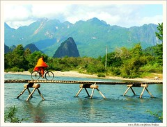 Scene in My Dream (Araleya) Tags: life travel bridge mountain rural river landscape lumix fz20 colorful asia southeastasia vivid monk panasonic colourful laos lao vangvieng socialdocumentary araleya songriver impressedbeauty travelerphots