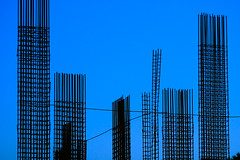empty city (♫ marc_l'esperance) Tags: blue sky abstract geometric lines silhouette vertical contrast canon eos construction crossing dusk geometry abstractart © angles 2006 minimal line 10d forms duotone tall abstraction minimalism minimalist rebar allrightsreserved cml intersecting canonef70200mmf28lusm ef70200mmf28l canon70200f28l