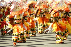 Inayawan (Farl) Tags: road street party orange colors concrete dance shadows dancers philippines cebu tradition mardigras sinulog contingent cebusugbo sinulog2007 inayawan