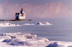 Kewaunee mist (James Jordan) Tags: winter lighthouse mist snow cold ice wisconsin clouds wow bravo frost quality 100v10f lakeeffect blueribbonwinner kewaunee magicdonkey stuckmenageriegroup6 earthshots colorphotoaward flickrdiamond