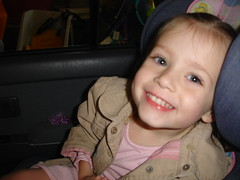 Grace smiling in car