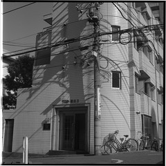 Wires and Shadows (gullevek) Tags: blackandwhite 6x6 film bicycle japan architecture geotagged iso100 tokyo fuji wires electricity    housebuilding scannedfromnegative  fujineopanacros100 rolleiflex28c epsongtx900 geo:lat=35562242 geo:lon=139722777